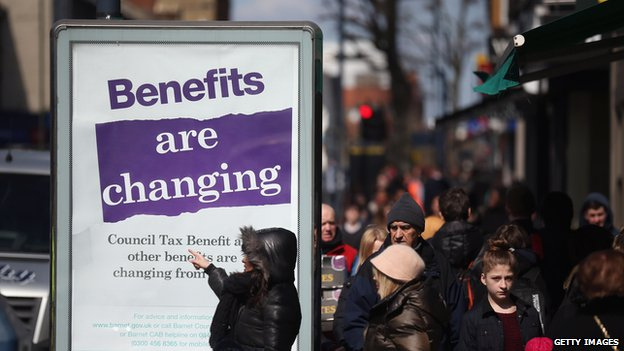 A poster informing pedestrians of changes to the benefits and tax system, on 2 April 2013, in London