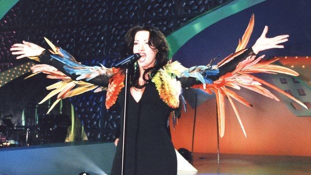 Dana International with bird feathers