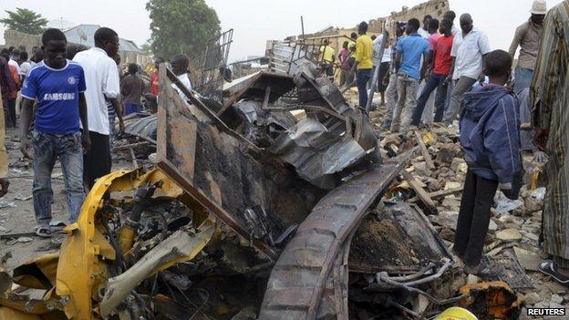 File photo: People look at damage in a market area after a bomb explosion in Ajilari-Gomari near the city's airport, Maiduguri, Borno State, Nigeria 2 March 2014