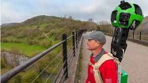 Peak District National Park Ranger with Google Trekker backpack on the Monsal Viaduct, Peak District