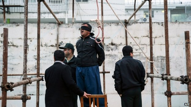 Balal, who killed Iranian youth Abdollah Hosseinzadeh in a street fight with a knife in 2007, reacts as he stands in the gallows during his execution ceremony in the northern city of Nowshahr on 15 April 2014
