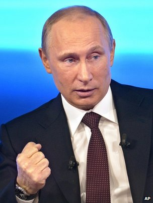 Russian President Vladimir Putin takes part in a TV show in Moscow, 17 April