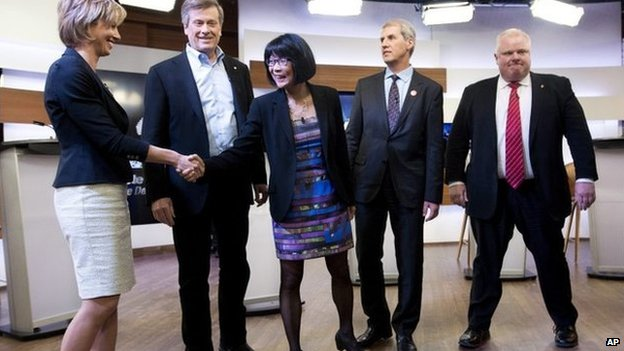 Karen Stintz, (left to right) John Tory, Olivia Chow, David Soknacki and Rob Ford shake hands before the first Toronto mayoral debate in Toronto on 26 March 2014