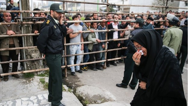 Samereh Alinejad cries after she spared the life of her son's convicted murderer with an emotional slap in the face as he awaited execution with the noose around his neck in the northern city of Nowshahr on April 15, 2014