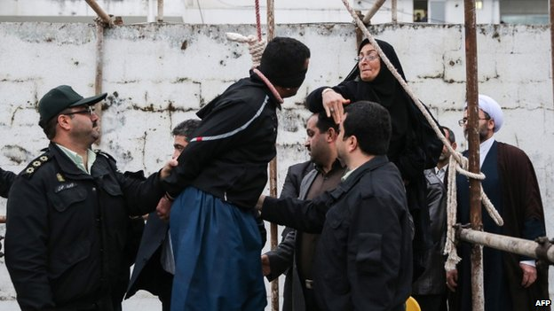 The mother (R) of Abdollah Hosseinzadeh slaps the face of Balal, who killed her son, on 15 April 2014
