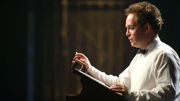 Tom Hollander as Dylan Thomas