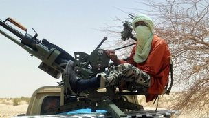 An Islamist rebel is pictured on near Timbuktu, in rebel-held northern Mali