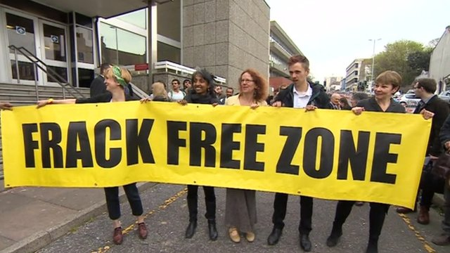 Caroline Lucas and other protesters outside court