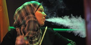 A woman smoking a shisha in Ramallah