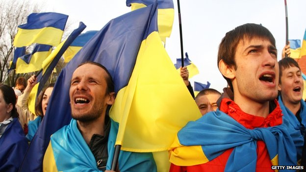 Ukrainians with their national flags gather in support of a united Ukraine in Donetsk, Ukraine