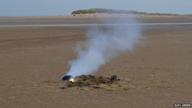 Flames from a device found on Holkham beach