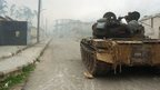 A tank on a street in the town of Zara, in the province of Homs, during fighting between Syrian forces and rebels (8 March 2014)