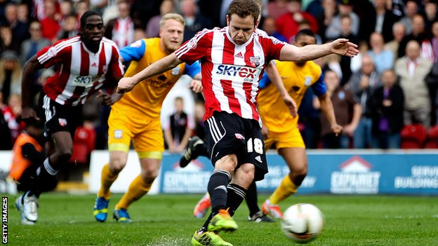 Alan Judge scores for Brentford against Preston North End as the Bees seal promotion to the Championship