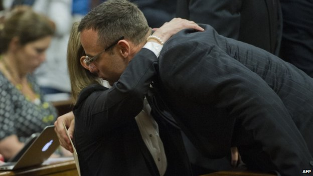 Oscar Pistorius hugs a family member in court (17 April 2014)