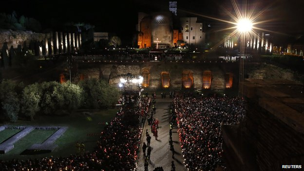 Pope Francis leads the Via Crucis (Way of the Cross) torchlight procession celebrated in front of the Colosseum on Good Friday in Rome, Friday, April 18