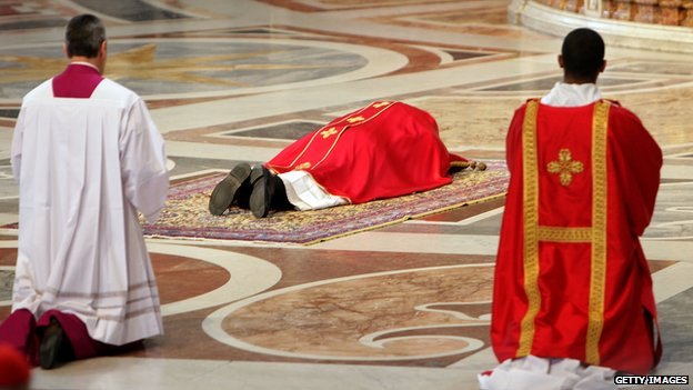 "Pope Francis prays on the floor during a Papal Mass with the Celebration of the Lord""s Passion inside St Peter""s Basilica on April 18"