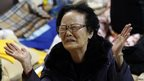 A family member cries as she waits for news from a rescue team at a gym in Jindo.