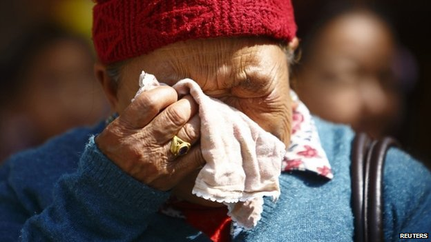 The mother of Kaji Sherpa cries as she waits for the body of her son to arrive in Kathmandu - 19 April 2014
