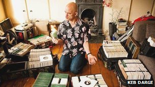 Keb Darge listening to some of his collection of 50s and 60s 7 inch singles
