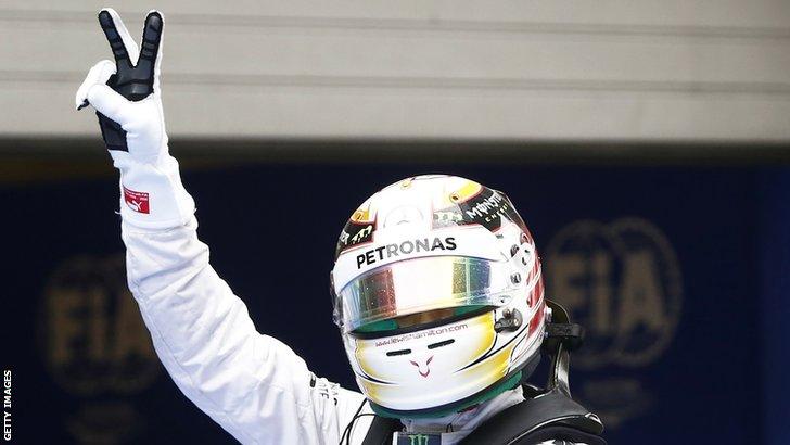 Lewis Hamilton celebrating.