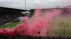 Smoke from smoke grenade at football stadium