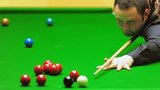 Stephen Maguire preparing to make his next shot