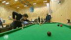 Kids playing snooker
