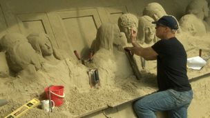Sand sculptor Mark Anderson recreating the last supper on the beach in Weymouth