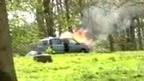 still from video showing car on fire