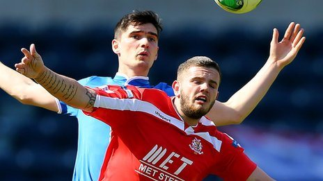 Jimmy Callacher of Linfield in action against Portadown's Darren Murray
