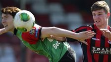 Glentoran's William Garrett in action against David McAllister of Crusaders