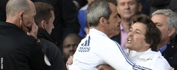 Rui Faria is restrained by Jose Mourinho