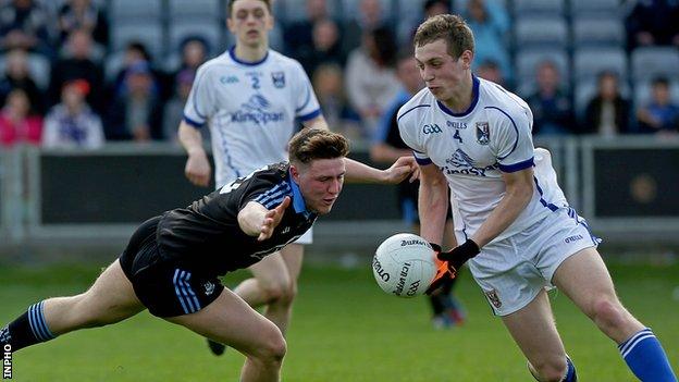 Dublin's John Small challenges Cavan defender Padraig Faulkner