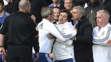 Jose Mourinho restrains Rui Faria as Mike Dean looks on
