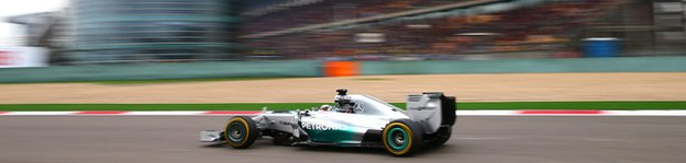 Lewis Hamilton of Great Britain and Mercedes GP leads the Chinese Formula One Grand Prix at the Shanghai International Circuit on April 20, 2014 in Shanghai, China.