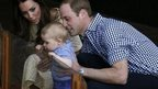 The Duchess of Cambridge and Prince William watch as their son Prince George looks at a Bilby