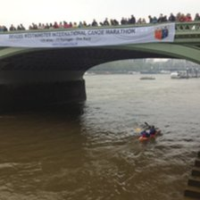 Canoeist cross the finish line