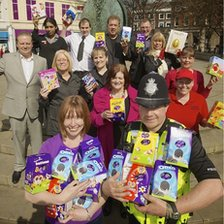 Police officers and volunteers from Rosie's Helping Hands with chocolate Easter eggs