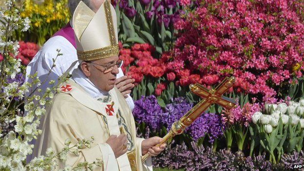 Pope Francis walks past the flowers in St Peter's Square on 20 April 2014