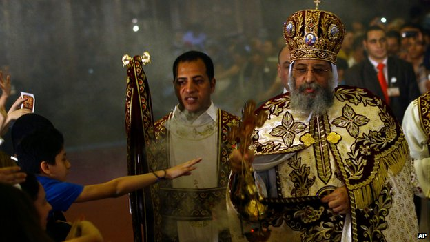 Coptic Pope Tawadros II celebrates Easter Eve service at St Mark's Cathedral in Cairo, Egypt, on 19 April 2014