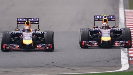 Sebastian Vettel of Germany and Infiniti Red Bull Racing competes with teammate Daniel Ricciardo of Australia and Infiniti Red Bull Racing during the Chinese Formula 1 Grand Prix.