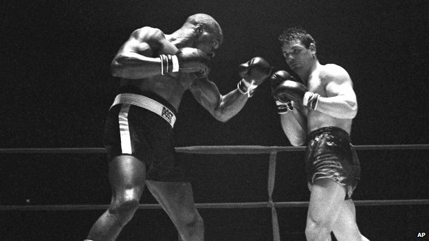 "File photo: Rubin ""Hurricane"" Carter, left, knocks out Italian boxer Fabio Bettini in the 10th and last round of their fight at the Falais Des Sports in Paris, 23 February 1965"