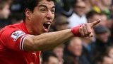 Luis Suarez celebrates scoring for Liverpool
