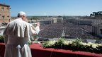 Pope Francis waves to the crowd in St Peter's Square on 20 April 2014
