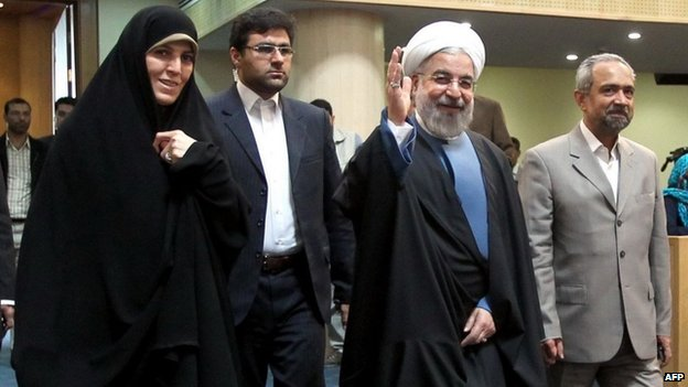 Iranian President Hassan Rouhani (second right) at a forum to mark Women's Day in Iran, 20 April 2014