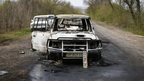 Burnt cars are seen at the scene of an overnight gunfight near a checkpoint near the city of Slaviansk April 20