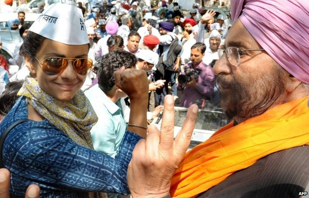 Bollywood actress Gul Panag (left) wore a Gandhi cap during her election campaign in India