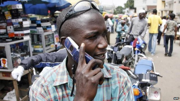 A motorcyclist on the phone in Nigeria - 2008