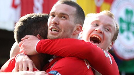 Cliftonville players celebrate a goal