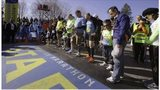 Mobility-impaired runners gather at the start line for a moment of silence before the 118th Boston Marathon Monday, April 21